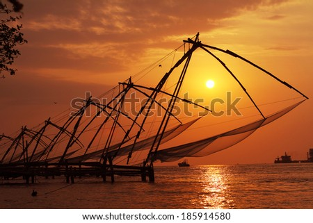 Sunset over Chinese Fishing nets in Cochin (Kochi), Kerala, India.  - stock photo