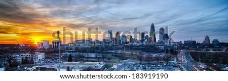 sunset over city of charlotte north carolina - stock photo