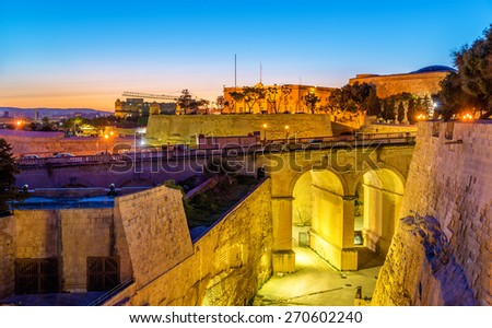 Sunset over city walls of Valletta - Malta - stock photo