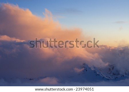 Sunset over clouds in mountains