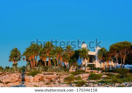 Sunset over colonial house - stock photo