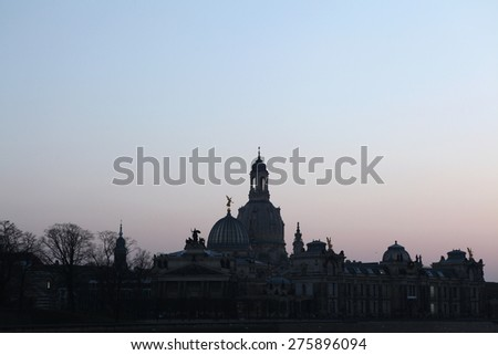 Sunset over domes of the Church of Our Lady (Frauenkirche) and the Academy of Fine Arts in Dresden, Saxony, Germany.  - stock photo