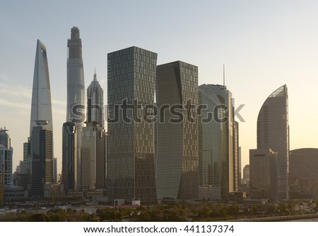 Sunset over downtown Shanghai skyline. View On The Huangpu River Waterfront And City Skyscrapers.