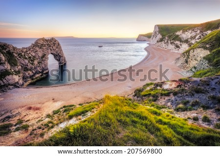 Sunset over Durdle Door in Uk. - stock photo