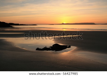 Sunset over Eigg in February. - stock photo