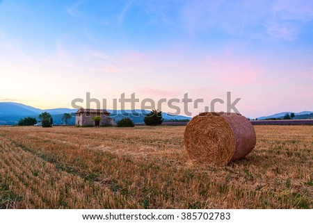 Sunset over farm field with hay bales near Sault, Provence-France