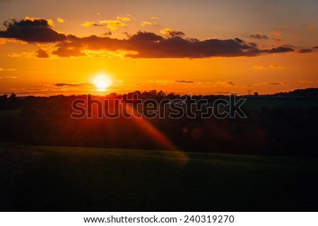 Sunset over fields and hills in rural York County, Pennsylvania - stock photo