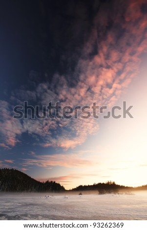 sunset over frosted lake - stock photo