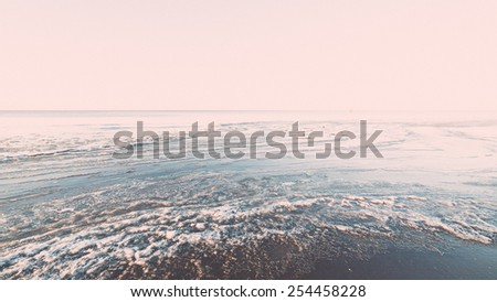 sunset over frozen sea with ice blocks and dramatic colorful sky - vintage retro grainy film effect