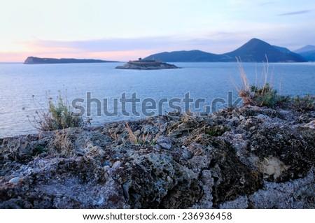 Sunset over island - stock photo