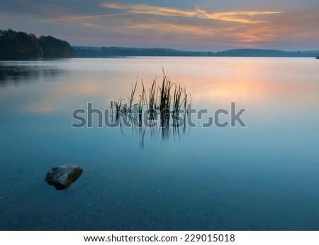 sunset over lake  - stock photo