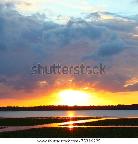 Sunset over Lake Arbuckle of the Lake Wales Ridge State Forest in central Florida - stock photo