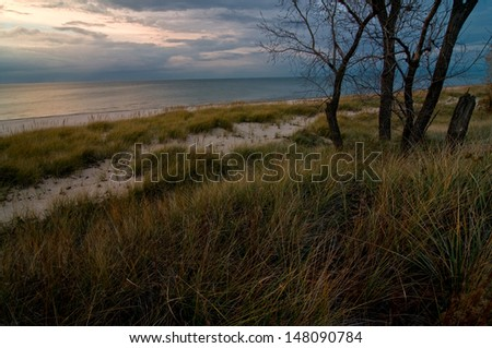 Sunset over Lake Michigan at Indiana Dunes National Lakeshore. - stock photo
