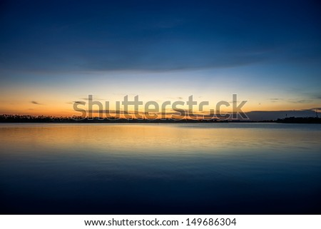 sunset over lake with reflection - stock photo