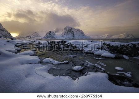 Sunset over Lofoten islands, Norway in winter - stock photo