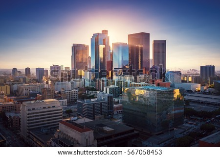 Sunset over Los Angeles downtown. Retro colors. California theme. LA background. Los Angeles city center.