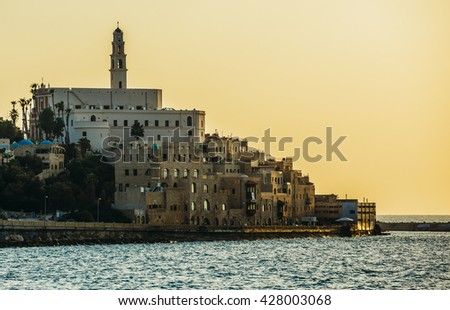 Sunset over Mediterranean Sea and old city of Jaffa in Tel Aviv, Israel - stock photo