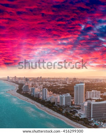 Sunset over Miami Beach skyline, helicopter view.