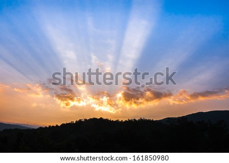 sunset over mountain, sunbeam, hope light - stock photo