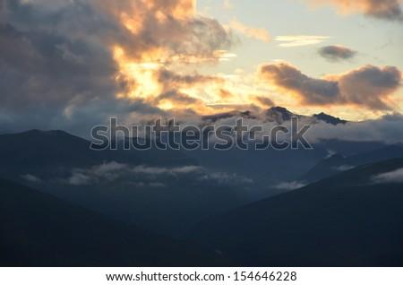 Sunset over Mountain Valley - stock photo