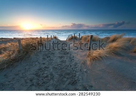 sunset over North sea beach, north Holland, Netherlands - stock photo