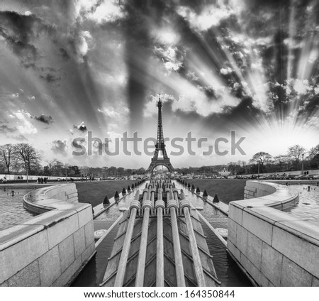 Sunset over Paris. Trocadero gardens with Eiffel Tower on background. - stock photo