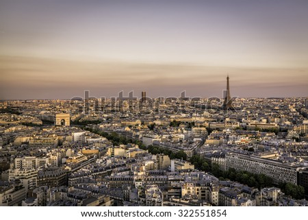 Sunset over Paris with Eiffel Tower and Arch de Triumph, Paris - stock photo