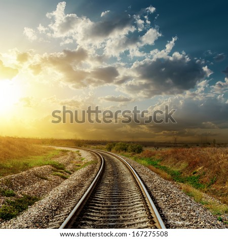 sunset over railroad
