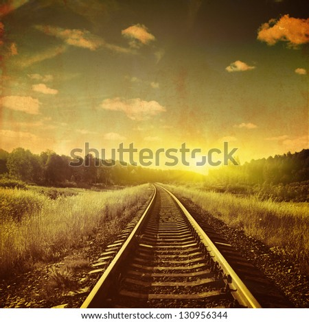 Sunset over railroad in grunge and retro style. - stock photo