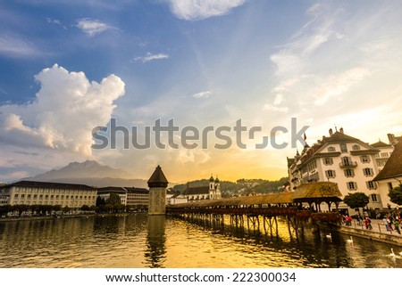 Sunset over river Reuss in Lucerne, Switzerland - stock photo