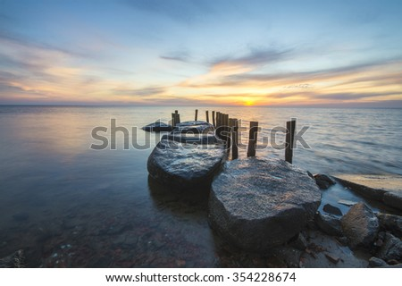 Sunset over rocky beach in Wolin national Park on Wolin Island,Poland