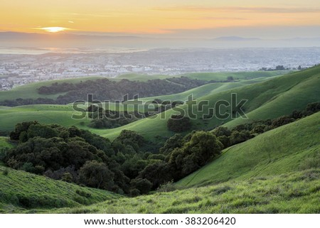 Sunset over San Francisco Bay Area from East Bay Hills - stock photo