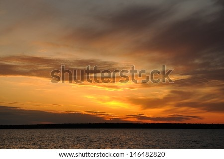 Sunset Over Sand Island of the Apostle Islands in Wisconsin - stock photo
