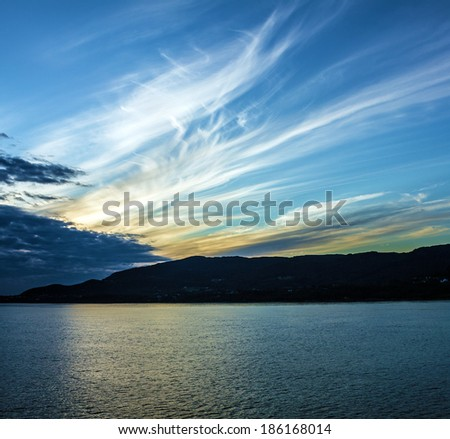Sunset over sea and mountain, Norway fjords - stock photo
