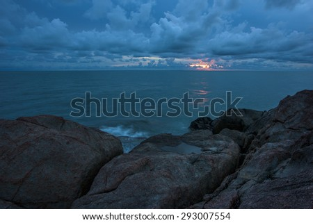 sunset over sea  with storm - stock photo