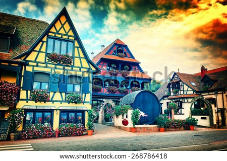 Sunset over small town with typical half-timbered houses. Alsace, France - stock photo