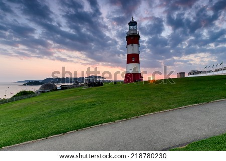 Sunset over Smeaton's Tower the lighthouse that stands on the Hoe in Plymouth, Devon - stock photo