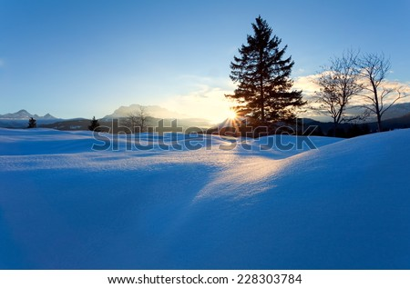 sunset over snow hills in Alps, Bavaria, Germany - stock photo