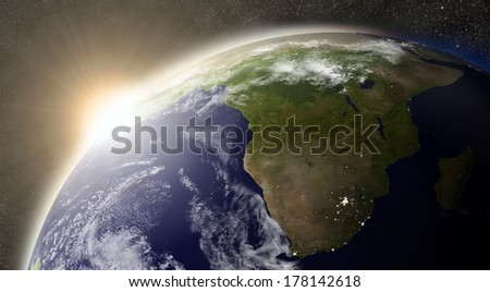 Sunset over South Africa region on planet Earth viewed from space with Sun and stars in the background. Elements of this image furnished by NASA. - stock photo
