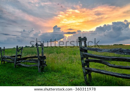 Sunset over split rail fence from the Cumberland Gap National Park - stock photo