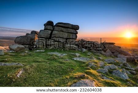 Sunset over Staple Tor near Merrivale on dartmoor National Park in Devon - stock photo