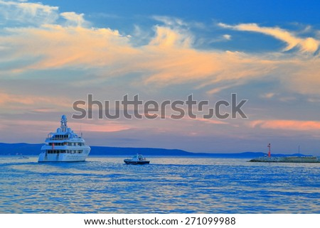 Sunset over the Adriatic sea with luxury yacht leaving the harbor, Split, Croatia - stock photo