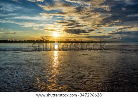 Sunset over the Amazon river near Leticia, Colombia - stock photo