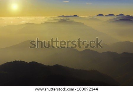 Sunset over the Apuane Alps, Tuscany, Italy. The Apuan Alps (Italian: Alpi Apuane) are a mountain range in northern Tuscany, Italy, part of the Apennine Mountains. / Mountain sunset - stock photo