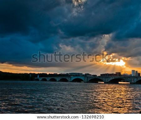 Sunset over the Arlington Memorial Bridge on the Potomac River, seen from Washington, DC - stock photo
