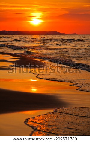 Sunset over the Baltic Sea in Swinoujscie, Poland - stock photo