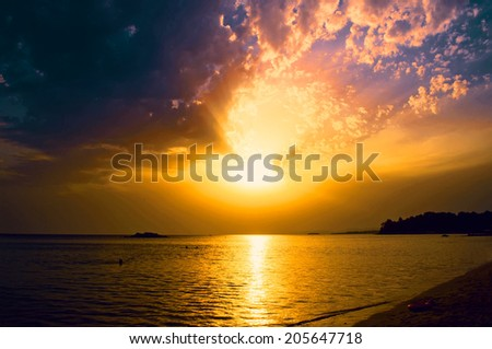 Sunset over the beach - stock photo