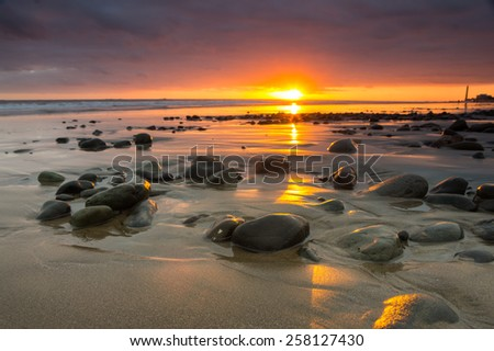 Sunset over the coast of Atlantic ocean, Gran Canaria, Canary islands, Spain - stock photo