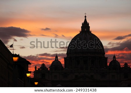 Sunset over the dome of Saint Peter's Basilica in Vatican City in Rome, Lazio, Italy.  - stock photo