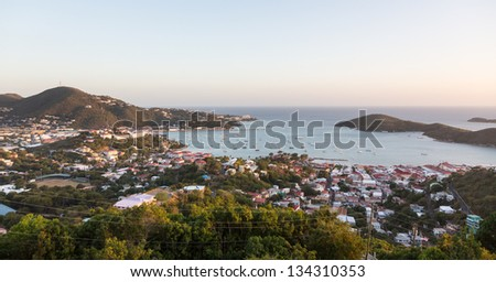 Sunset over the harbor of Charlotte Amalie in St Thomas with view over town and yachts in bay